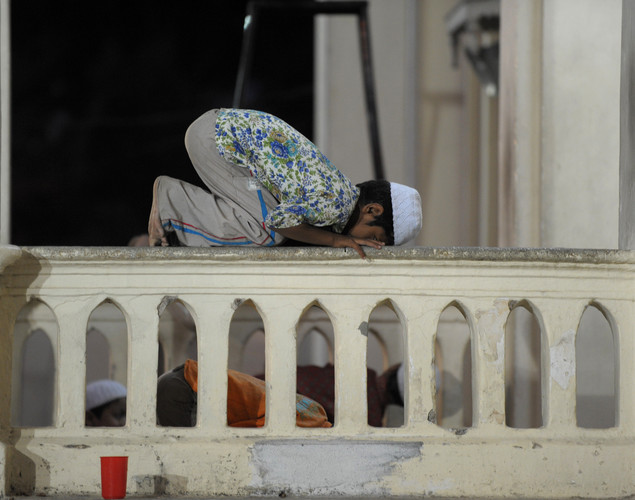 An Indian Muslim boy offers prayers at Jama-e-Masjid Aiwan-e-Begumpet mosque during the holy month of Ramadan in Hyderabad.