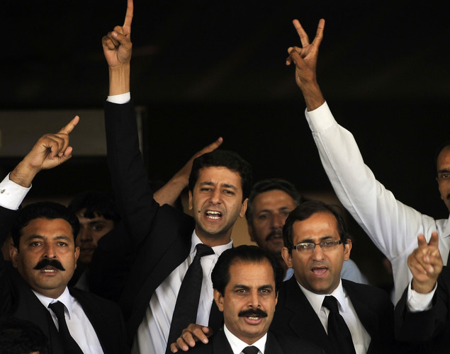 Pakistani lawyers shout slogans against Pakistani Prime Minister Yousuf Raza Gilani following the verdict against him at the Supreme Court in Islamabad.