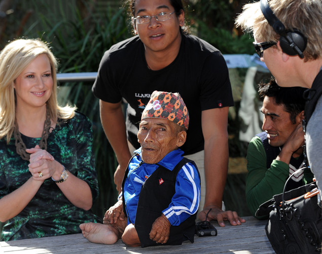 Chandra Bahadur Dangi (C), the 72-year-old Nepali crowned the 'world's shortest man' by Guinness World Records, is surrounded by media and translators in Sydney.