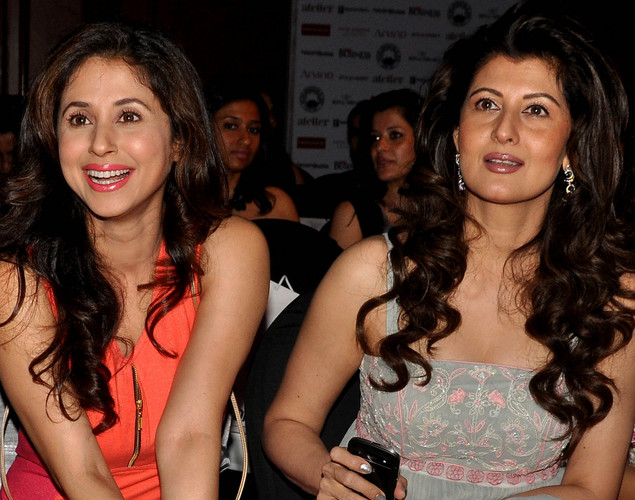 Urmila Matondkar (L) and Sangeeta Bijlani pose as they attend  a Cotton Council International Celebrates Cottonscape fashion show in Mumbai.