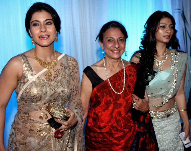 Bollywood film actress Kajol (L), her mother Tanuja Mukherjee (C) and sister Tanisha pose during the wedding reception of film actress Esha Deol and husband Bharat Takhtani in Mumbai.