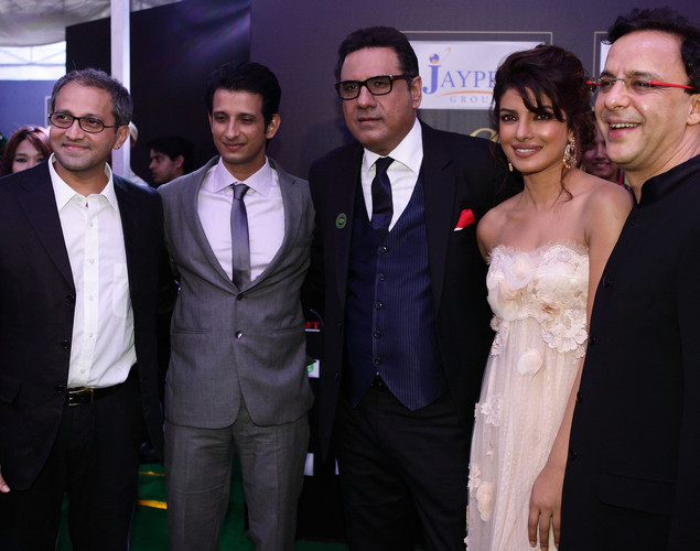 Vidhu Vinod Chopra, Sharman Joshi, Boman Irani, Priyanka Chopra and Rajesh Maspukar pose at the IIFA green carpet event at the 2012 International India Film Academy Awards at the Singapore Indoor Stadium.
