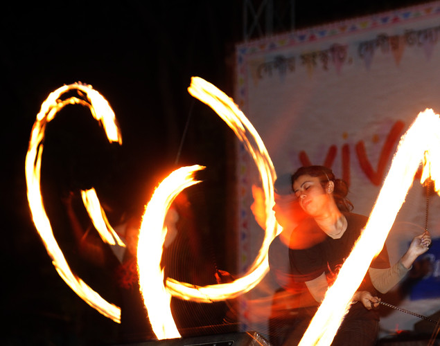 A Bangladeshi woman performs a fire dance on the day of the Chaitra Sangkranti (last day of the Bengali year) in Dhaka.