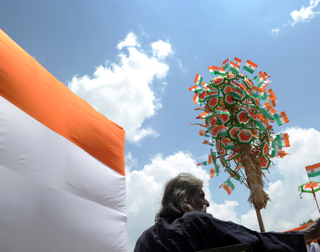 A street vendor sells trinkets adorned with the Indian Flag at the Indian Gate monument during Independence Day celebrations in New Delhi on August 15, 2012.