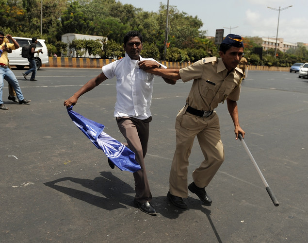 Indian police detain Republican Party of India activists as they tried to stop traffic on the western express highway during a nationwide strike in Mumbai.