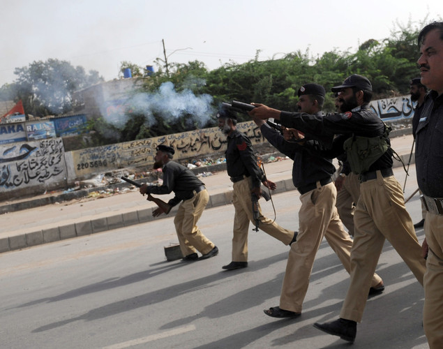 Pakistani policemen fire tear gas shells toward the protesters belonging to Islami Jamiat-e-Talaba, a student wing of the hard line Sunni party Jamaat-e-Islami (JI), near the US consulate during a protest against an anti-Islam movie in Karachi.