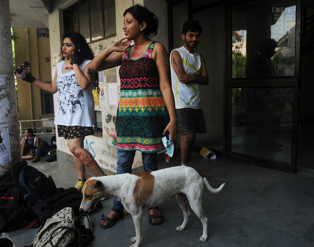 Students and social activists wait put on make-up prior to particiapting in a 'Slut Walk' in Kolkata.