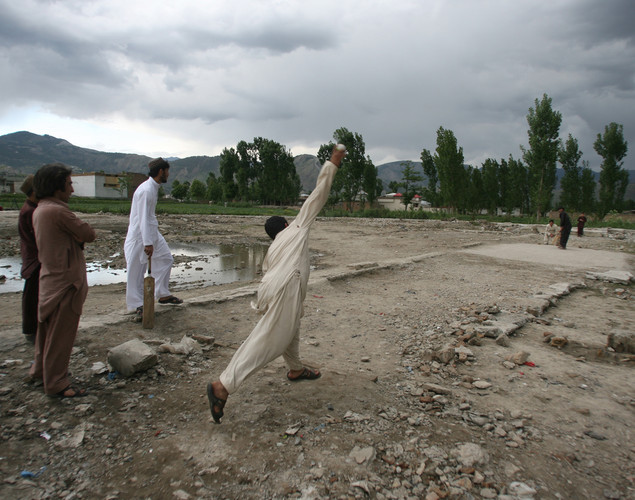 Local residents play cricket at the site of the demolished compound of slain Al-Qaeda leader Osama bin Laden in northern Abbottabad.