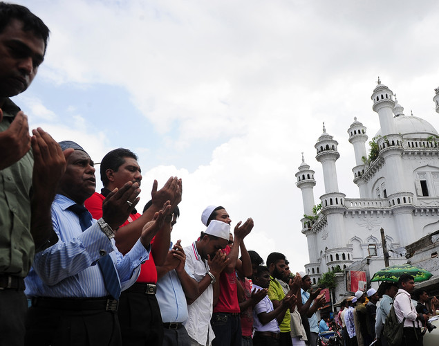 Sri Lankan Muslims take part in Friday noon prayers in Colombo on April 27, 2012.
