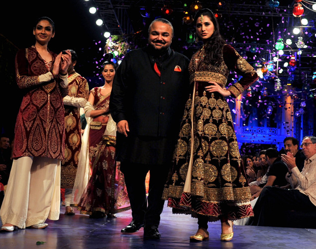 US fashion model and actress Nargis Fakhri (R) walks the ramp for designer JJ Valaya (2R) during the Grand Finale of Aamby Valley India Bridal Fashion Week 2012 in Mumbai.
