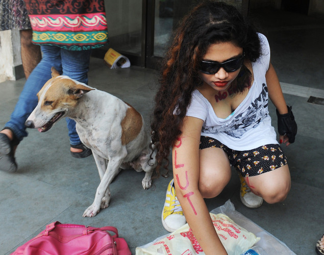 A social activist puts on make-up prior to particiapting in a 'Slut Walk' in Kolkata.