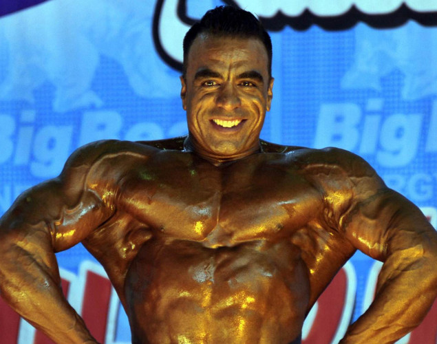 An Afghan bodybuilder preforms during the Mr. Afghanistan nation wide bodybuilding competition in Kabul. Bodybuilding is one of the country's most popular sports, even permitted during the 1996-2001 Taliban regime.