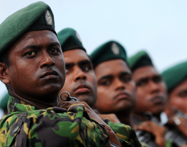 Sri Lankan Special Task Force (STF) soldiers march during a Victory Day parade rehearsal in Colombo.