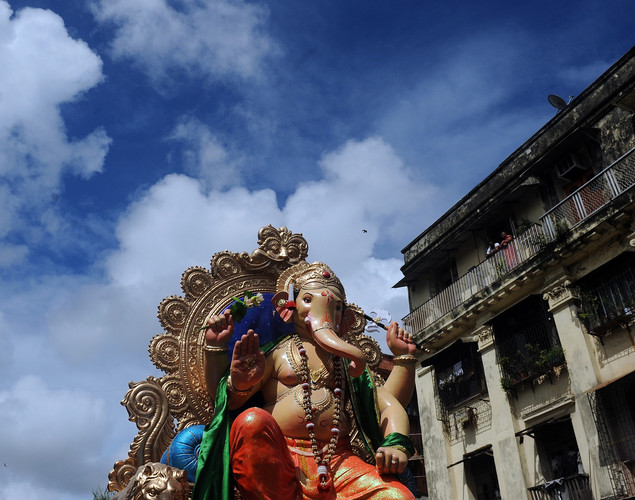 Residents watch from their balconies as Indian Hindus carry a huge idol of the elephant-headed Hindu god Lord Ganesha through the busy streets of Mumbai.