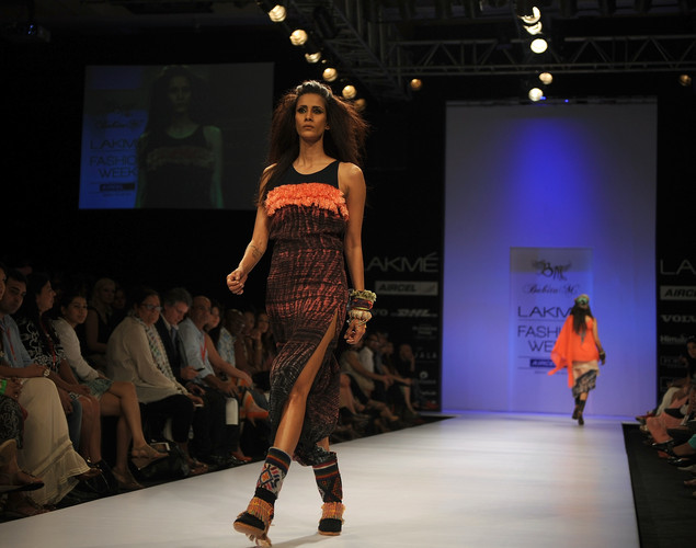Models showcase creations by designer Babita M on the second day of Lakme Fashion Week (LFW) winter/festive 2012 in Mumbai on August 4, 2012.