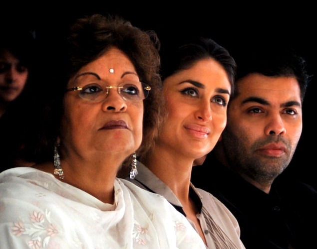 Indian Bollywood actress Kareena Kapoor (C) and director Karan Johar (C) with his mother Hiroo Johar (L) attend a catwalk presentation on the first day of Lakme Fashion Week (LFW) Winter/Festive 2012 in Mumbai on August 3, 2012.