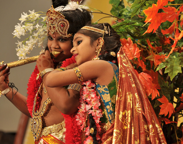 Young Indian Hindu devotees dressed as the Hindu God Lord Krishna (L) and his consort 'Radha' (R) dance during a fancy dress competition held at the International Society for Krishna Consciousness (ISKCON) temple in Bangalore on August 9, 2012 on the eve of 'Krishna Janmashtami'.