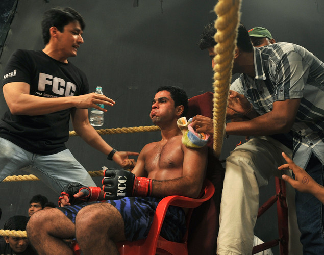 Indian student, judo practitioner and mixed martial arts (MMA) fighter Aditya Despande, 21, is freshened up and given tips in-between rounds during his bout at the FCC (Full Contact Championship) 6 fight night in Mumbai.