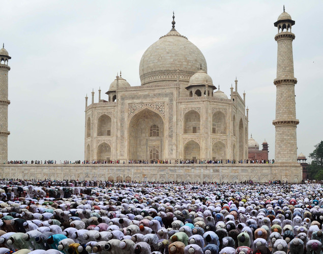 Indian Muslim devotees offer Eid al-Fitr prayers at the historic Taj Mahal in Agra.