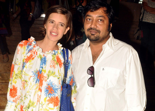 Anurag Kashyap (R) with wife Kalki Koechlin attend the second day of Lakme Fashion Week (LFW) summer resort 2012