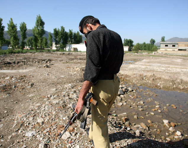 A Pakistani policeman walks at the site of the demolished compound of slain Al-Qaeda leader Osama bin Laden in northern Abbottabad.