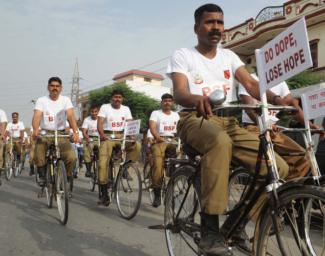 Indian Border Security Force (BSF) soldiers take part in a cycle race as part of an awareness campaign for International Day against Drug Abuse and Illicit Trafficking at BSF headquarters in Khasa.