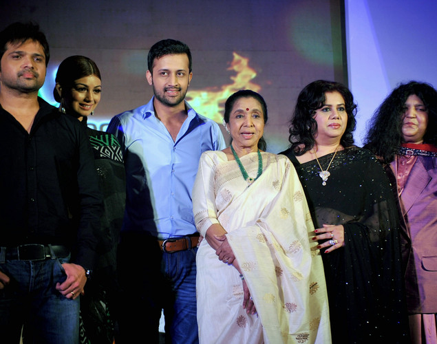 Indian singer and performer Himesh Reshmmiya, Indian actress Ayesha Takia, Pakistani pop singer Atif Aslam, Indian playback singer Asha Bhosle, Bangladeshi Singer Runa Laila and Pakistani Sufi Singer Abida Parveen pose during a media event for the television musical show 'Sur-Kshetra' In Mumbai.