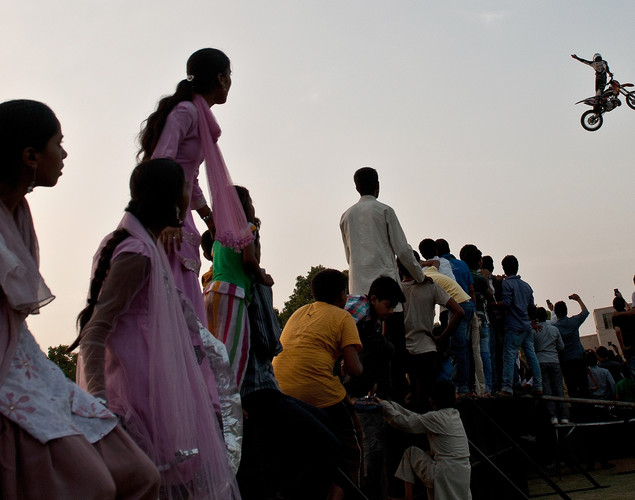Indian spectators watch as a Freestyle Motocross (FMX) RedBull X-Fighters rider perform at the India Gate in New Delhi.