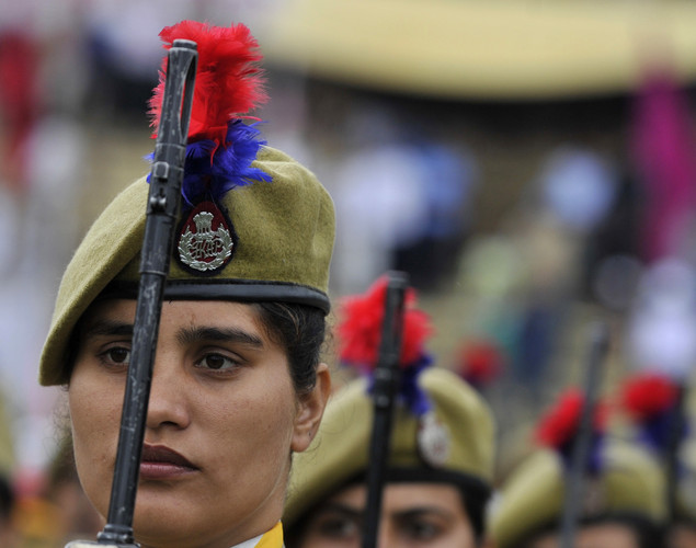 Jammu and Kashmir Armed Police (JKAP) servicewomen stand to attention during celebrations marking India's Independence Day at The Bakshi Stadium in Srinagar on August 15, 2012.