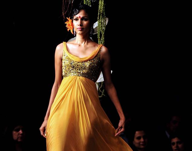 An Indian model showcases a creation by Indian designer Tarun Tahiliani on the opening day of Aamby Valley India Bridal Fashion Week 2012 in Mumbai.