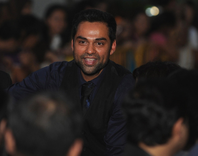 Bollywood actor Abhay Deol greets fans as he arrives at the green carpet to attend the premier of his new movie 'Shanghai' during the International Indian Film Academy (IIFA) awards event, in Singapore.