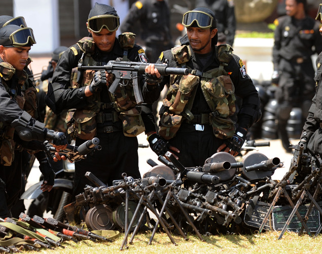 Sri Lankan army Special Force commandos interact during a Victory Day parade rehearsal in Colombo.
