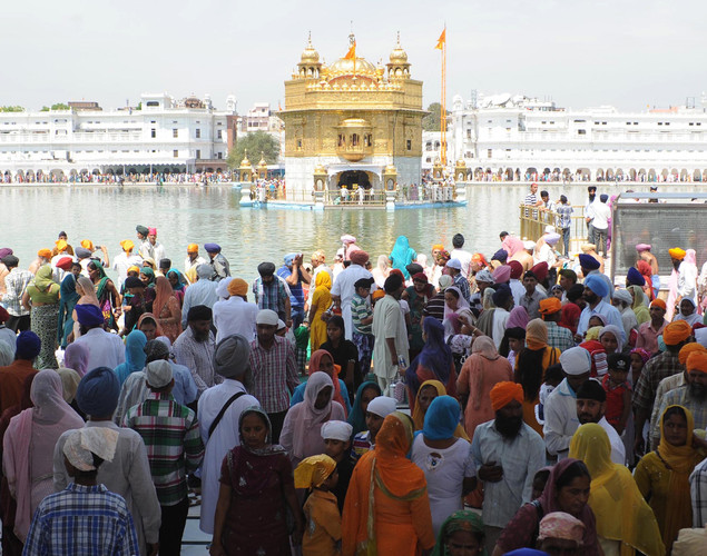 Indian Sikh devotees pay their respects to mark the Baisakhi festival at the Sikh Shrine Golden temple in Amritsar.