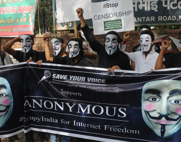 Activists supporting the group Anonymous wear masks as they protest against the Indian Government's increasingly restrictive regulation of the internet in New Delhi.