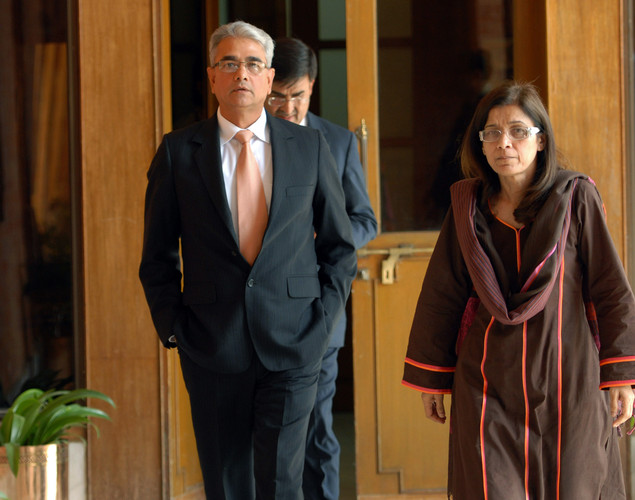 Pakistan Defense Secretary Nargis Seithi (R) and her Indian counterpart Shashikant Sharma arrive for talks at the Defence Ministry in Rawalpindi on June 12, 2012.