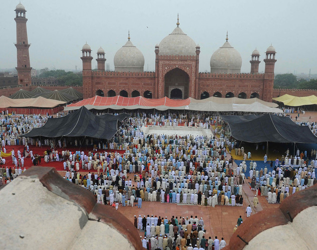 Pakistani Muslims offer Eid al-Fitr prayers at the Badshahi Masjid Mosque in Lahore.