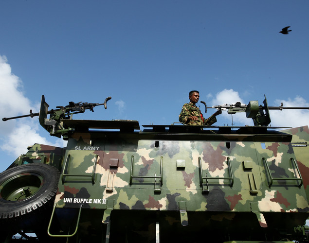 A Sri Lankan army vehicle takes part in military parade rehearsals in preparation for the celebration of the third anniversary of the end of the civil war and the defeat of the separatist Tamil Tiger rebels.