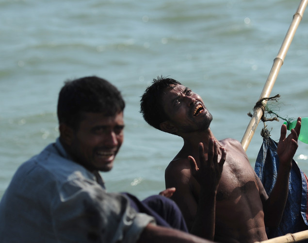A Rohingya Muslim cries as he tries to cross the Naf river in Teknaf.