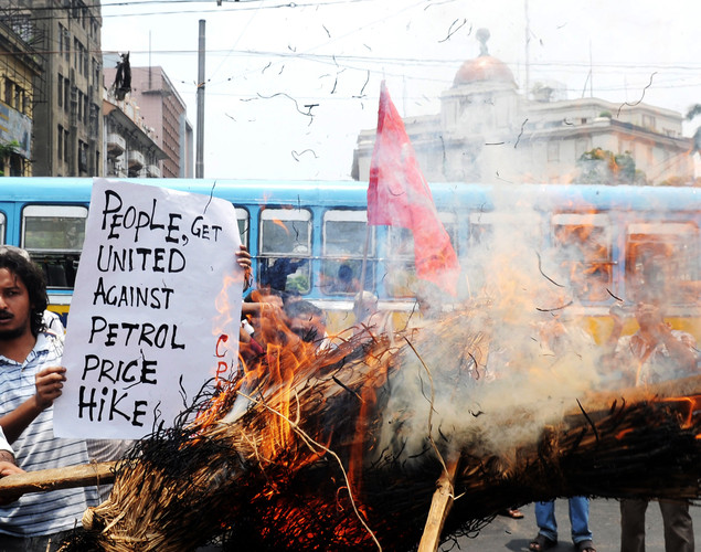 Activists of a leftist organisation burn an effigy of the prime minster Manmohan Singh in protest against the recent petrol price hike in Kolkata.