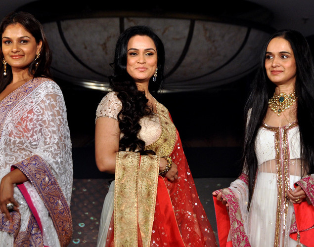 "Padmini Kolhapure (C) and her sister Tejaswini Kolhapure (L) and Shivangi (Kolhapure) Kapoor (R) display creations by designer Manish Malhotra for a public awareness campaign ""Save and Empower the Girl Child"" in Mumbai."