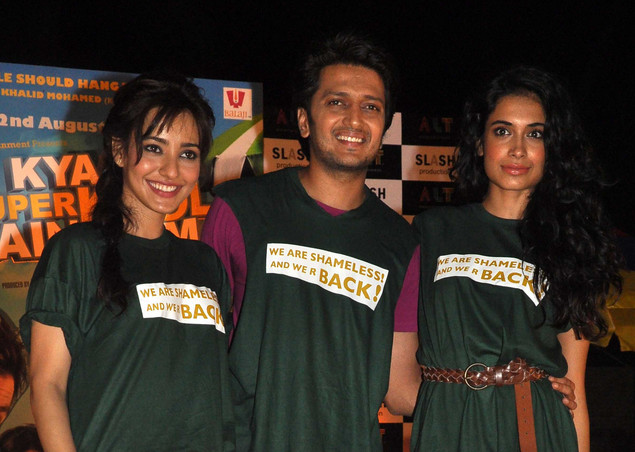 Ritesh Deshmukh (C) poses with Neha Sharma (L) and Sarah Jane Dias (R) during a promotional event for Hindi film Kyaa Super Kool Hai Hum