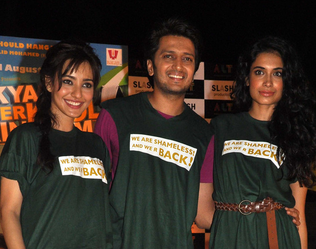 Ritesh Deshmukh (C) poses with Neha Sharma (L) and Sarah Jane Dias (R) during a promotional event for the forthcoming Hindi film Kyaa Super Kool Hai Hum directed by Sachin Yardi in Mumbai.