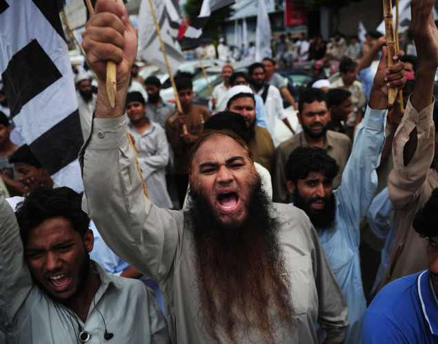 Activists of Jamaat-ud- Dawa Pakistan shout slogans at a rally in Karachi to denounce the resumption of NATO supplies into Afghanistan.