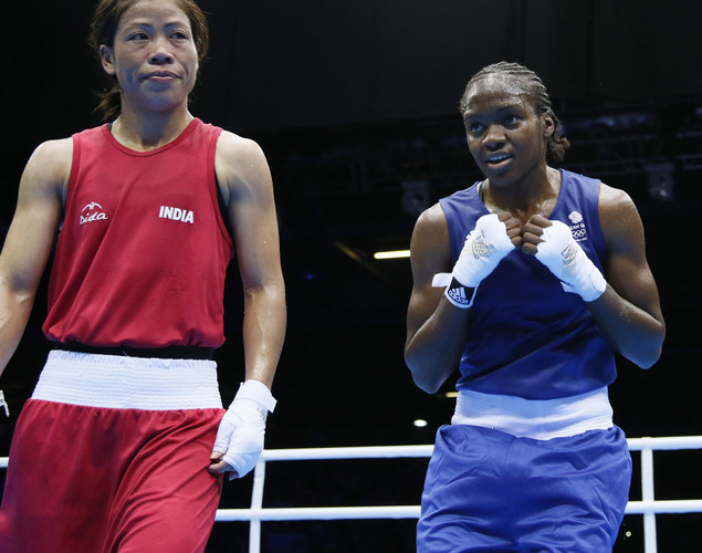 A disappointed M.C. Mary Kom of India (L) stands in the ring following her loss to Nicola Adams (R) of Great Britain in the women's Flyweight boxing semi-final match of the 2012 London Olympic Games at the ExCel Arena August 8, 2012 in London. Adams was awarded an 11-6 points decision. AFP PHOTO / Jack GUEZ (Photo credit should read JACK GUEZ/AFP/GettyImages)