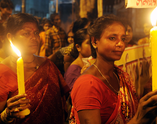 Indian sex workers hold candles as they march in a May Day rally asking for their rights and the recognition of their profession on the eve of the International Labor Day, in Kolkata on late April 30, 2012.