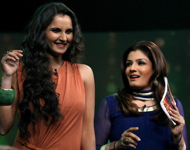 Indian tennis player Sania Mirza (L) interacts with Bollywood actress Raveena Tandon on the set of NDTV's television show 'Issi Ka Naam Zindagi' in Mumbai.