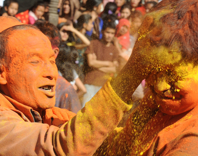 Nepalese revellers smear each others face with vermillion powder during The Bisket Jatra Festival at Thimi on the outskirts of Kathmandu.