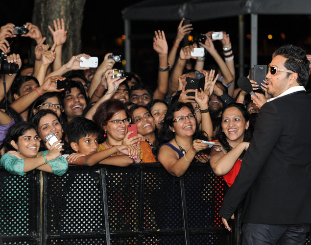 Bollywood singer Mika Singh (R) greets the fans during the International Indian Film Academy (IIFA) awards in Singapore.