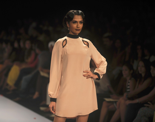 A model showcases a creation by Indian designer Pernia Qureshi on the second day of Lakme Fashion Week (LFW) winter/festive 2012 in Mumbai on August 4, 2012.