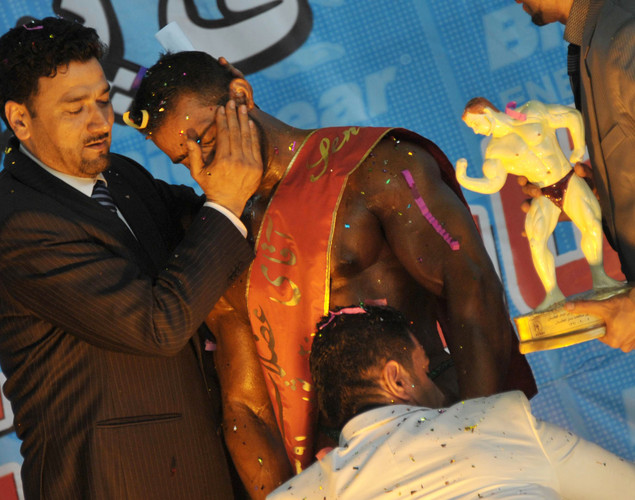 An official hugs Afghan bodybuilder, Mohammad Yousuf Sakhi (C) after he won the Mr. Afghanistan nation wide bodybuilding competition in Kabul. Bodybuilding is one of the country's most popular sports, even permitted during the 1996-2001 Taliban regime.